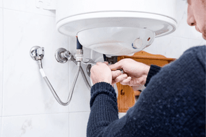 Guardian plumber fixing hot water heater.