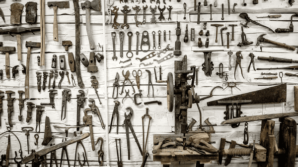 A wall with old-fashioned tools