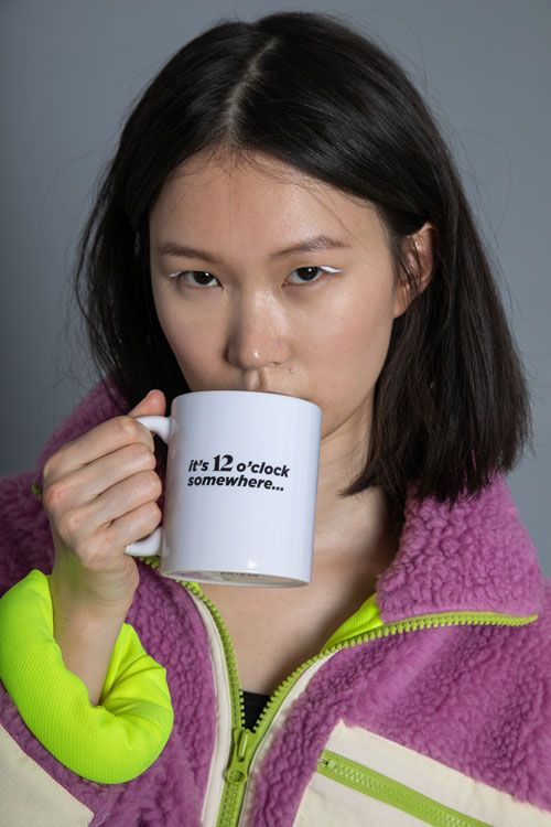 girl drinking from 12 branded ceramic cup