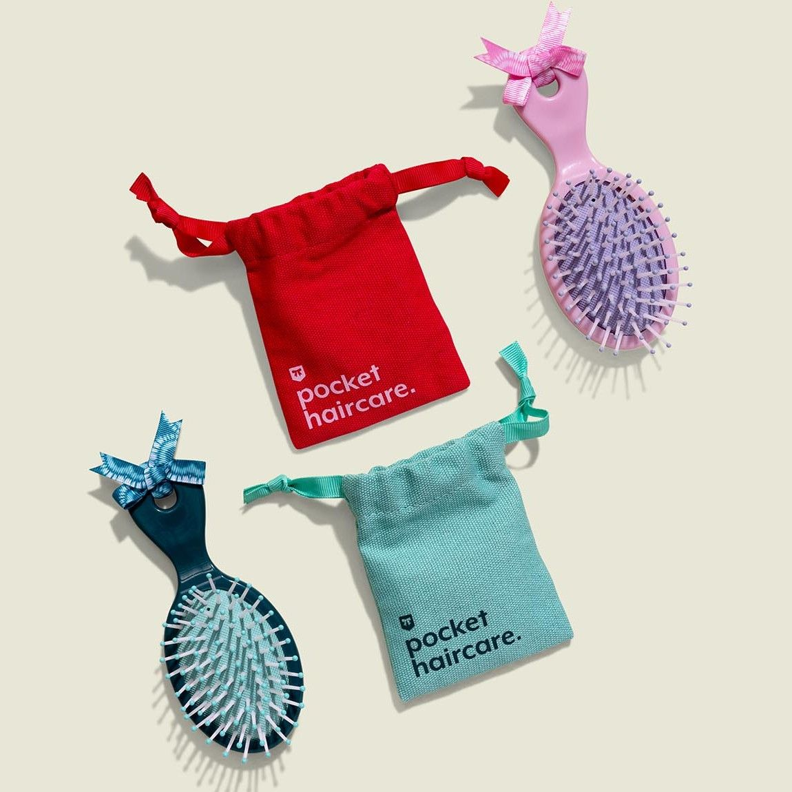 Drawstring pouches with hair brushes