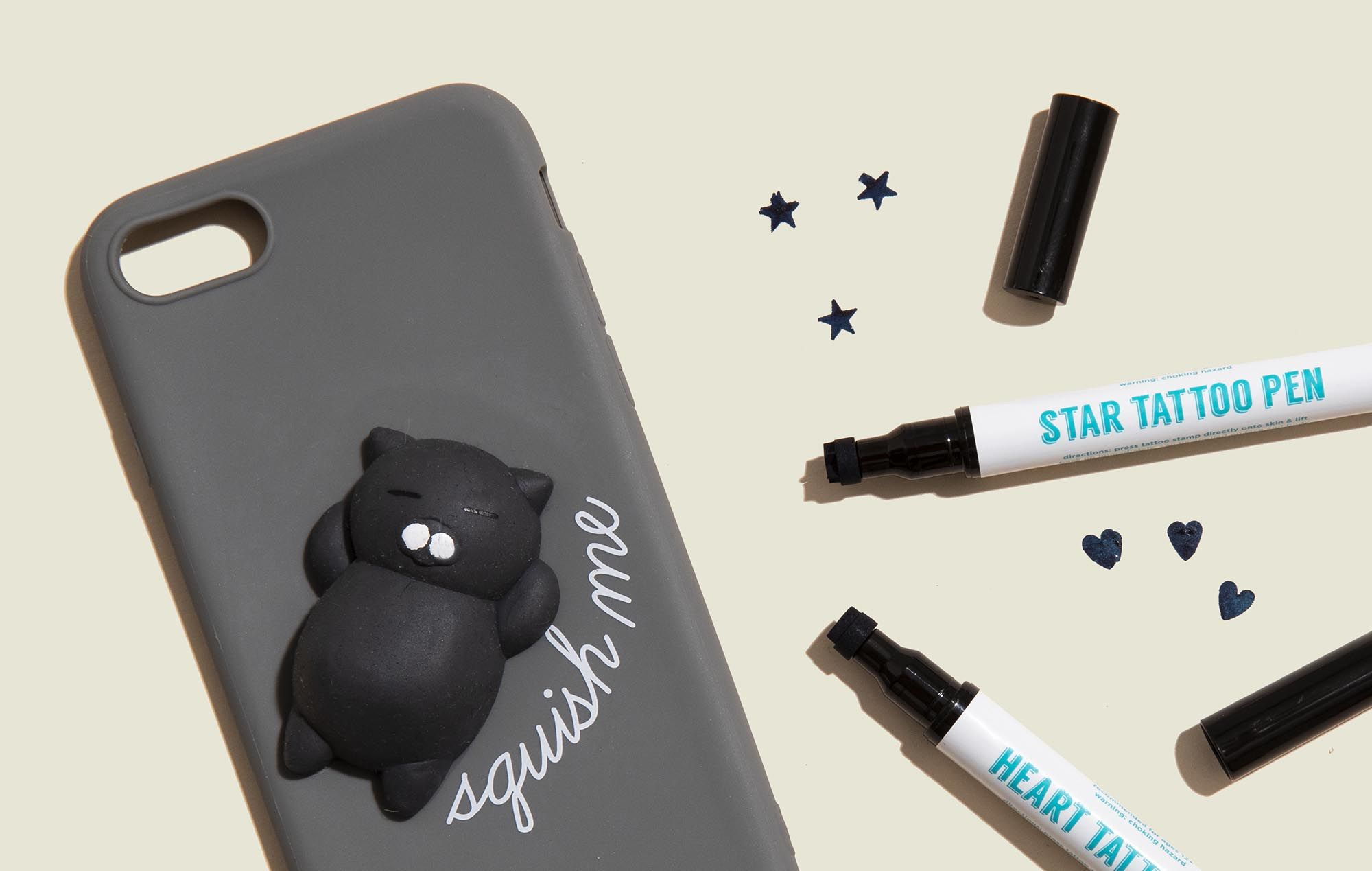 Phone case with tattoo pens