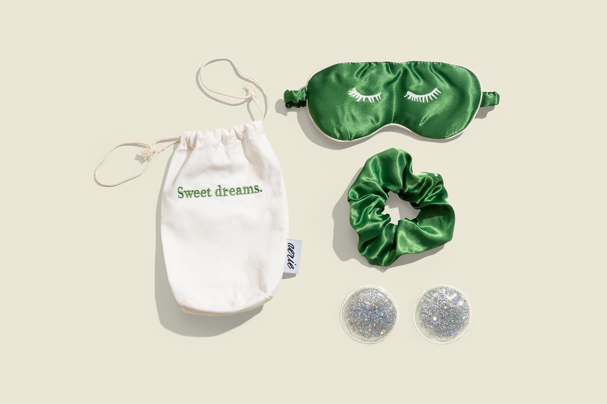 Drawstring pouch with scrunchie, sleep mask and glitter eye gel