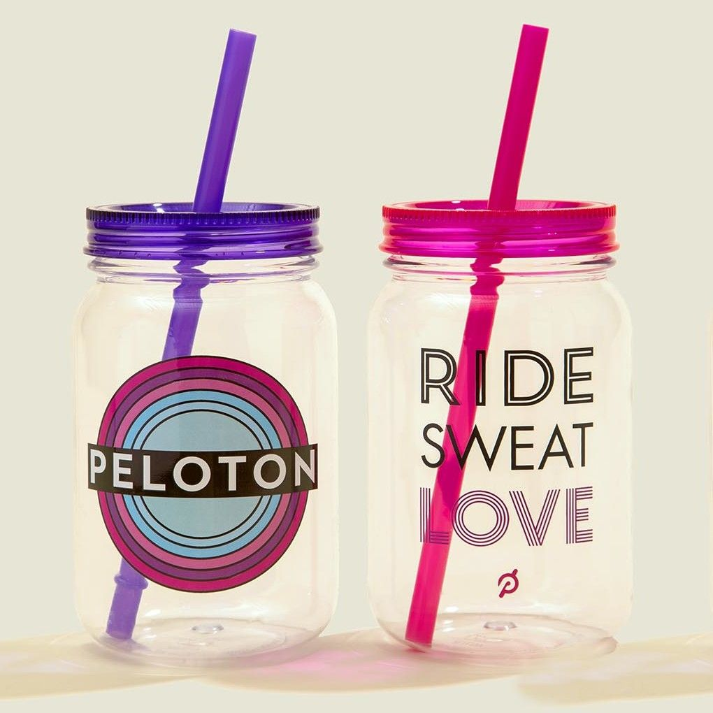 Set of colorful tumblers with straws