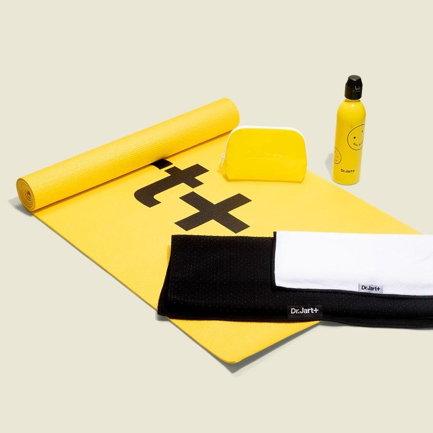 Yoga mat with water bottle, zip pouch and towels