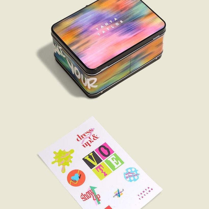 Metal container with stickers