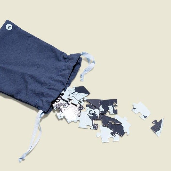 Drawstring pouch with puzzle pieces
