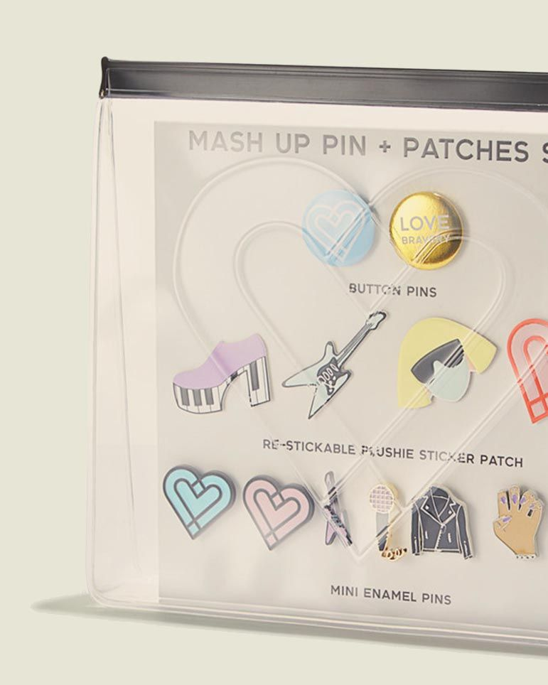 Set of pins and patches in clear pouch