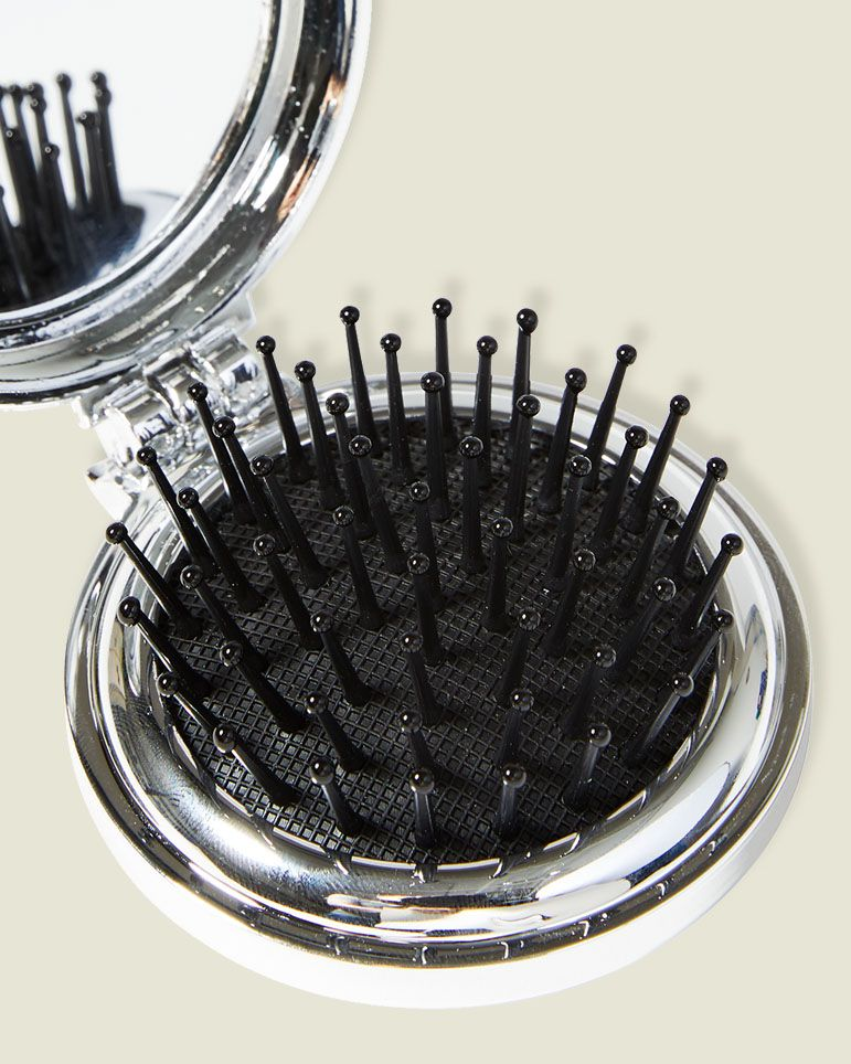 Compact mirror with hair brush