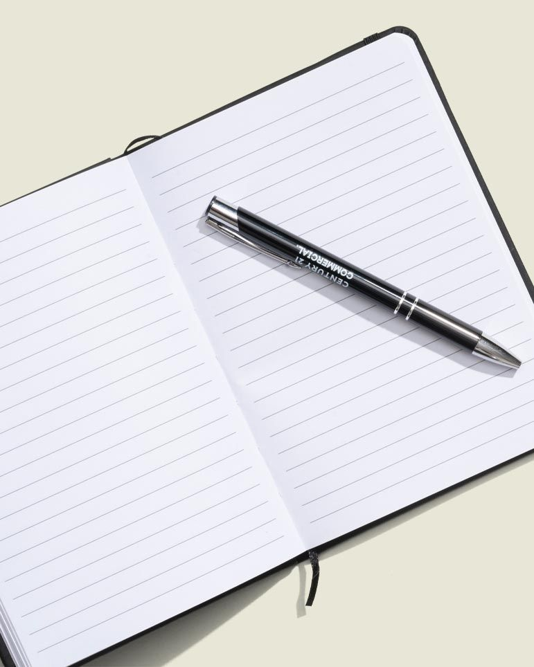 Opened journal with pen