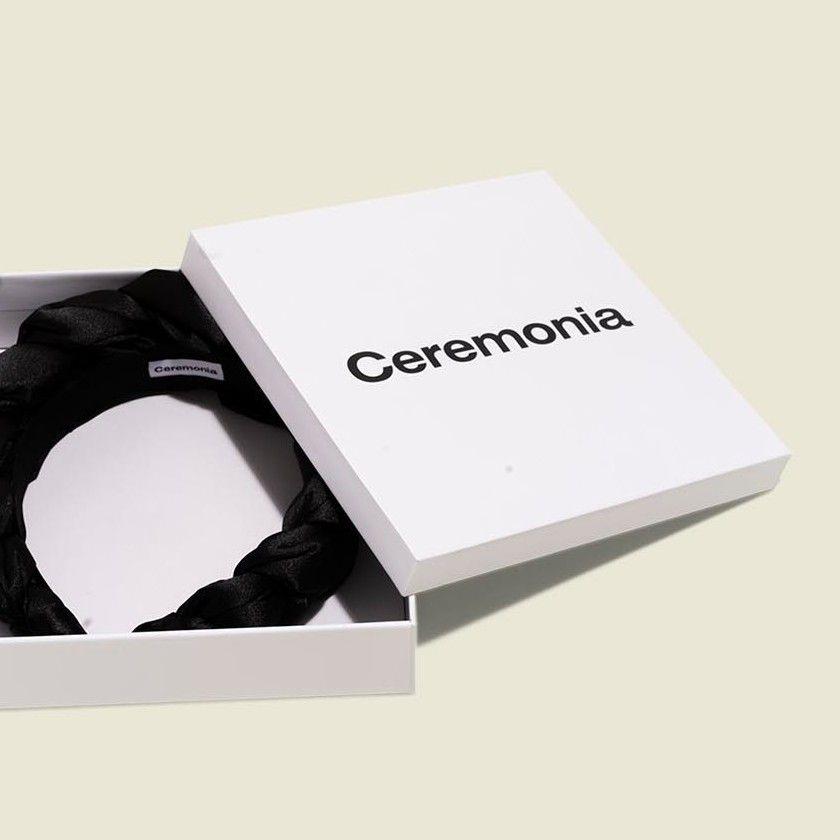 Custom packaging with braided black satin headband