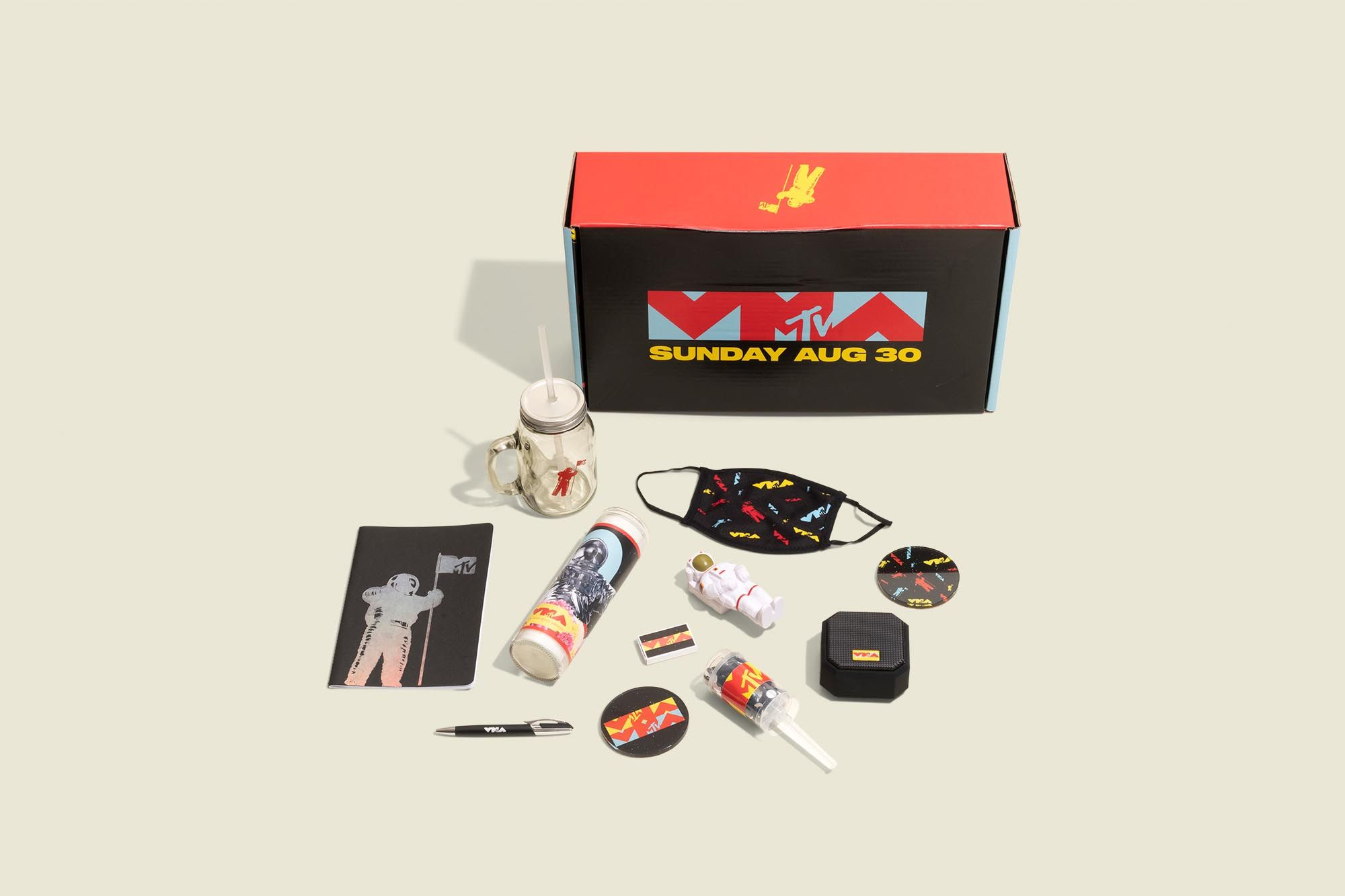 Printed box with face mask, candy, and other branded accessories