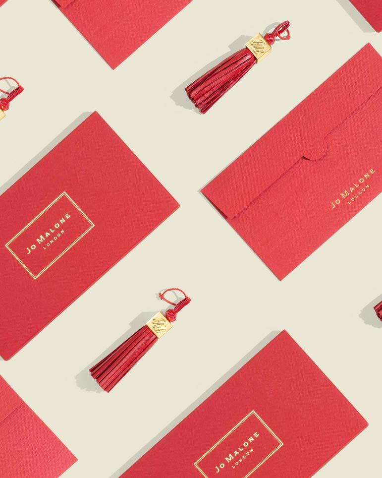 Red tassle with metal details with Custom red envelop