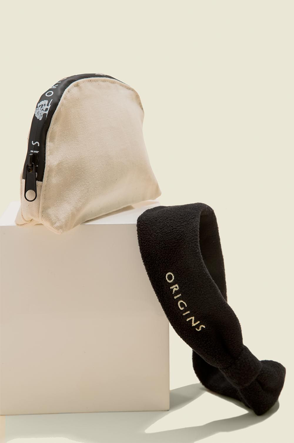Standing zip pouch with headband