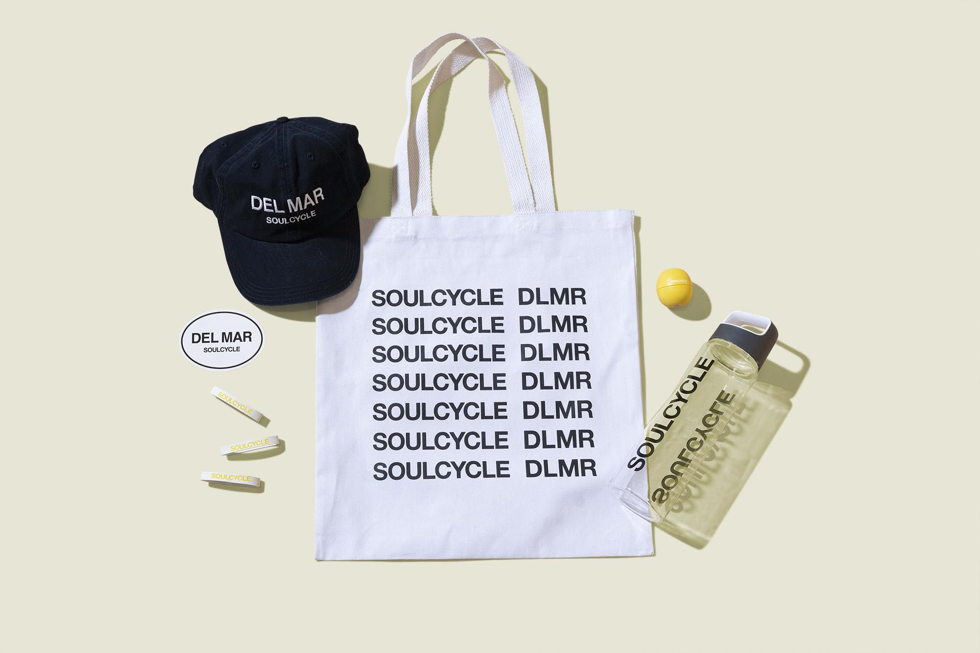 Tote bag with water bottle, wrist bands, hat, lip balm and sticker