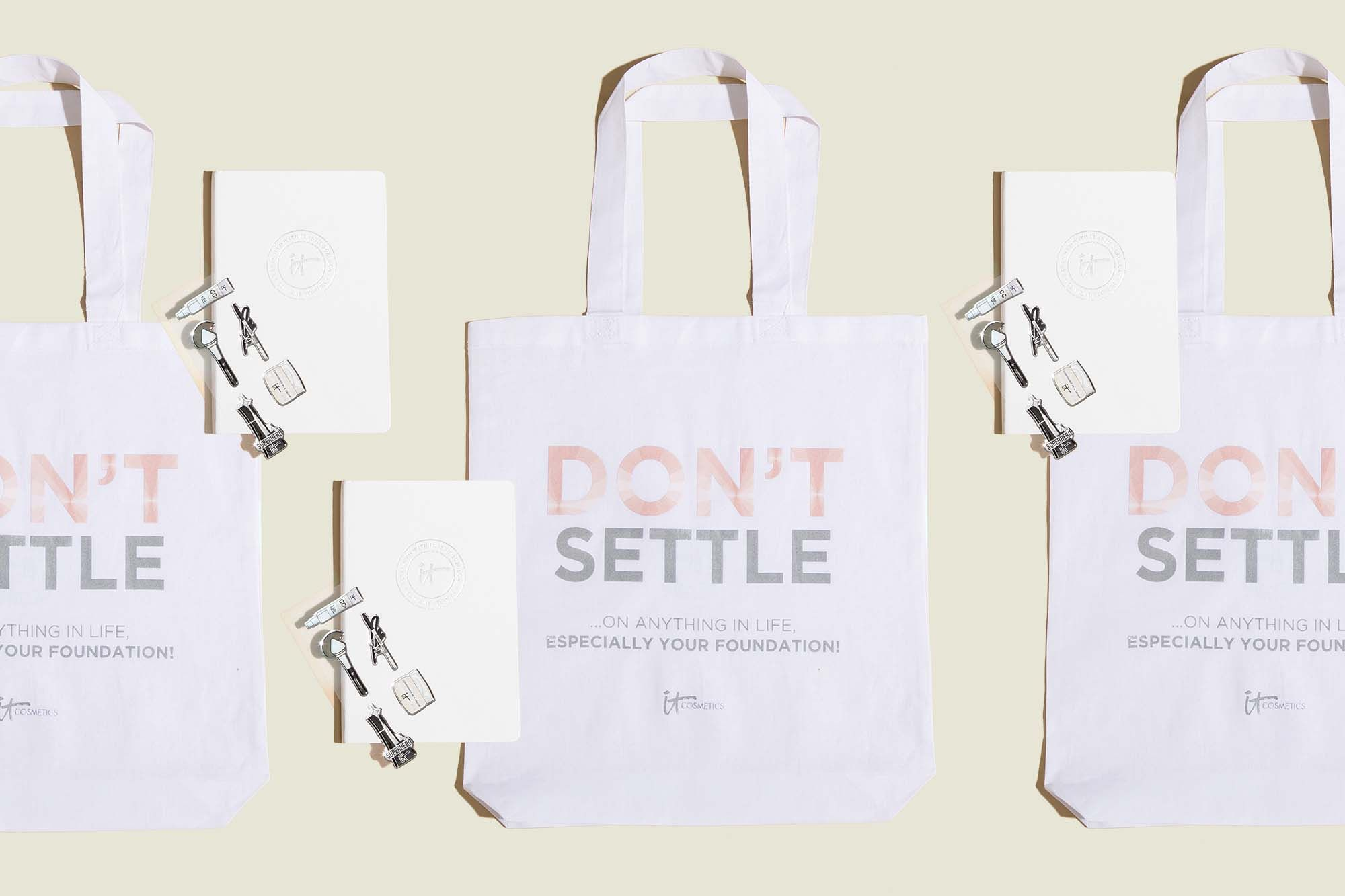 Tote bags with white journal and stickers