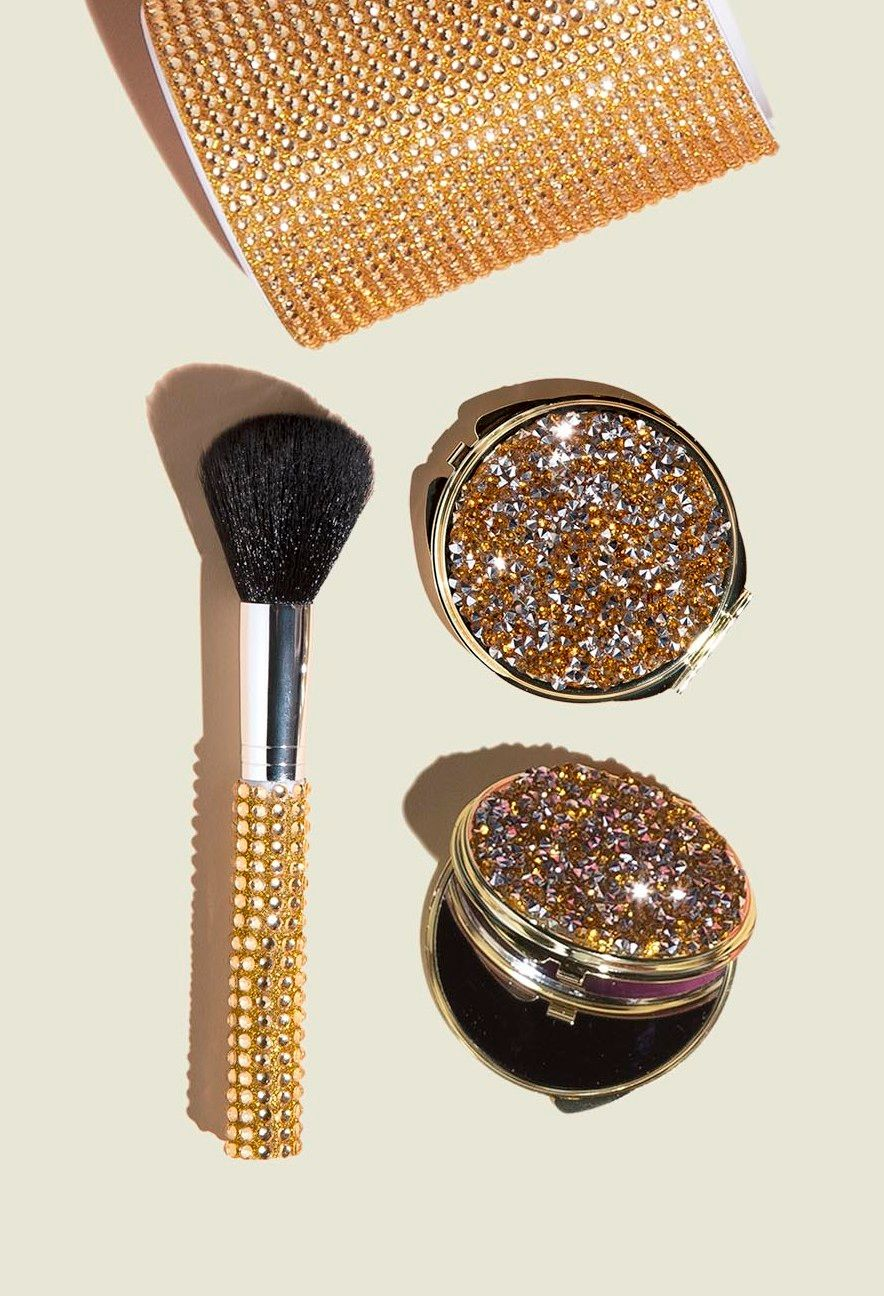 Makeup brush with compact mirrors