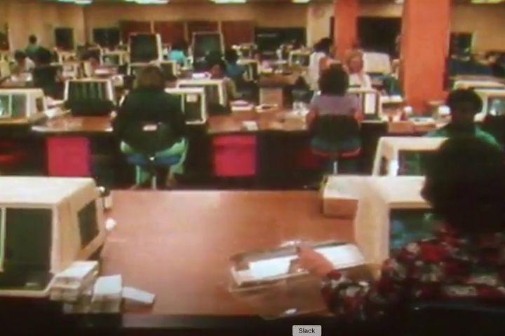 Vintage 70s era footage of a busy office