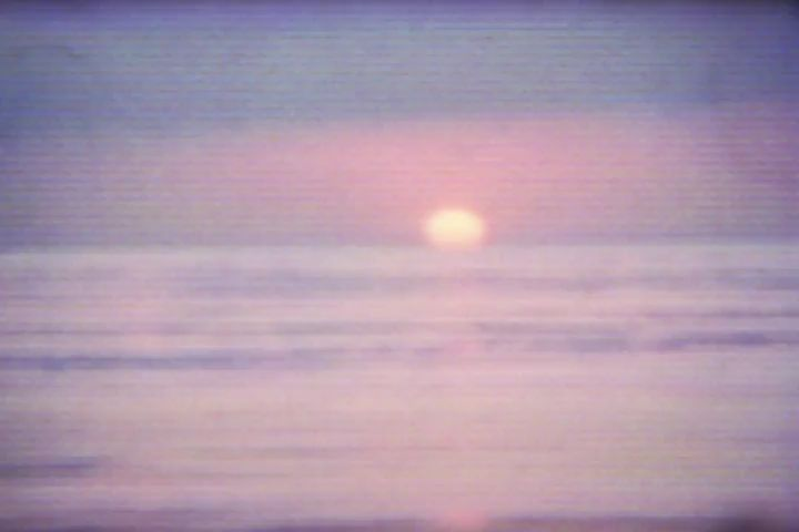 Vintage film of a pink and purple sunset