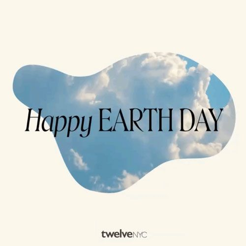 Happy earth day message over cloudy sky graphic