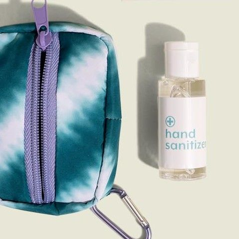 Standing zip pouch with hand sanitizer
