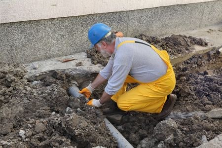 Our experienced plumbing contractor in the middle of a sewer line repair in Arvada, CO