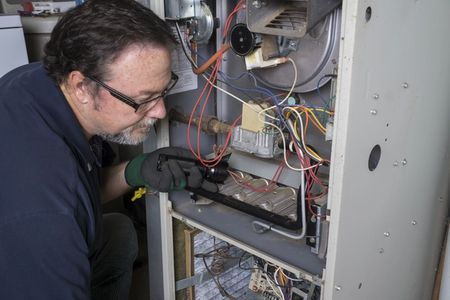 Our licensed heating contractor is performing standard furnace maintenance in Aurora, CO