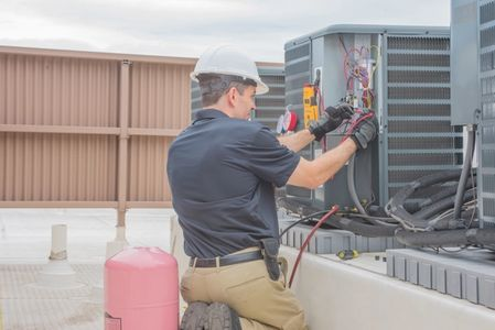 Our AC technician is performing a commercial air conditioning repair for a client in Evergreen, CO