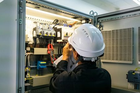 Our highly trained electrical technician doing commercial electrical panel work in Aurora, CO
