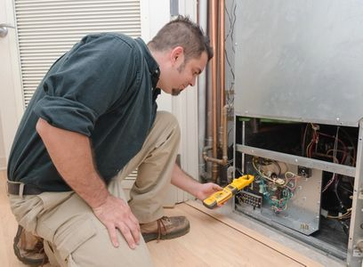 Our certified technician is performing the finishing touches on a commercial heating repair in Golden, CO