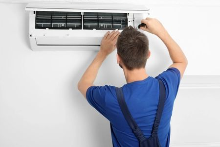 Our certified technician performing a standard air conditioner tune-up for a client in Golden, CO