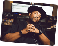 Sir Mix-A-lot sitting in a recording studio.