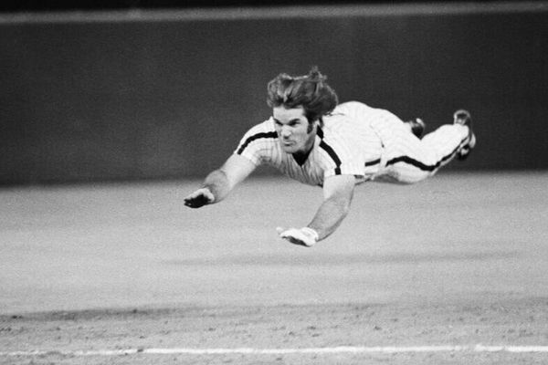 Pete Rose performing his signature headfirst dive at a game against the New York Mets in Philadelphia