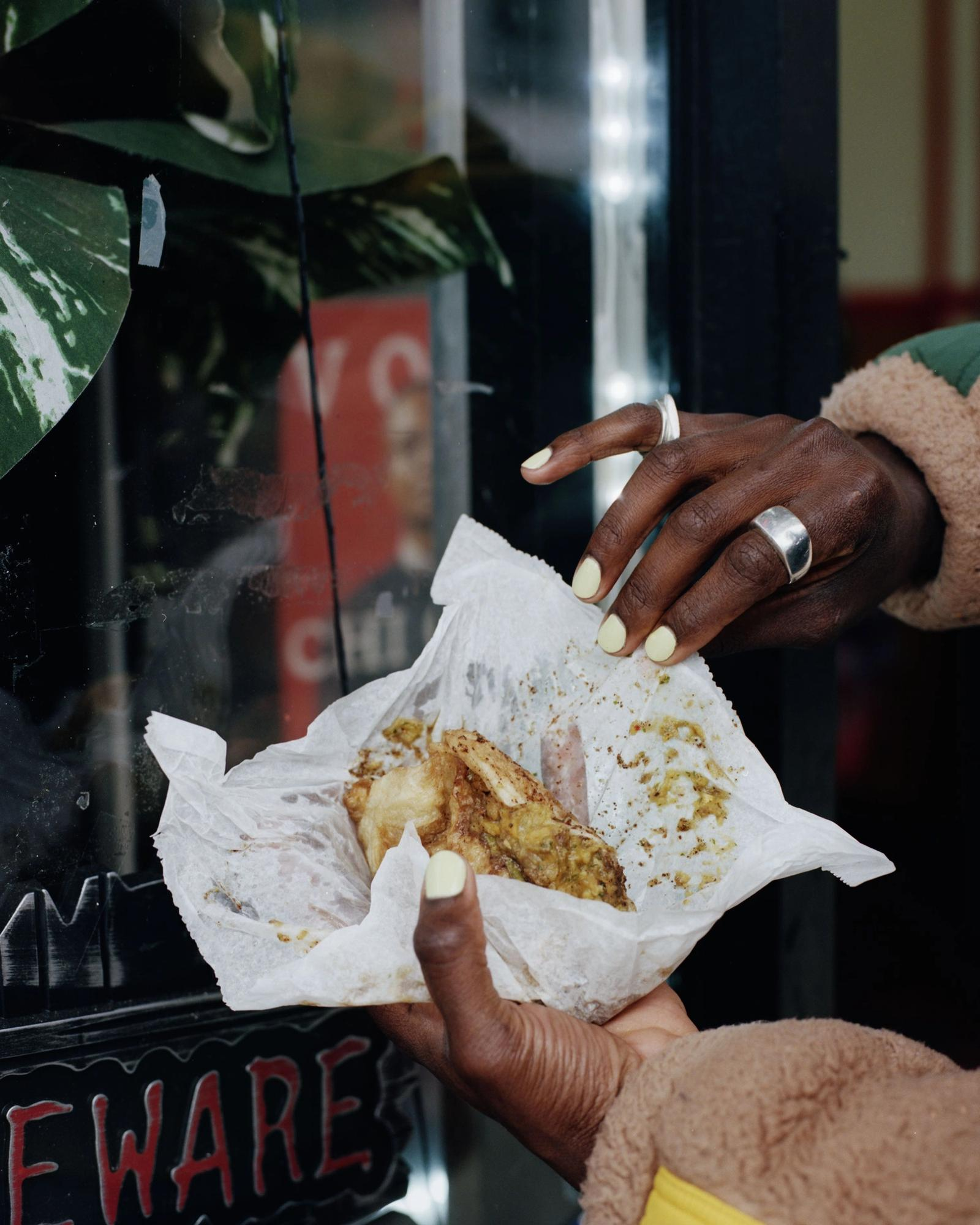 Devonn Francis' hands holding a curry.