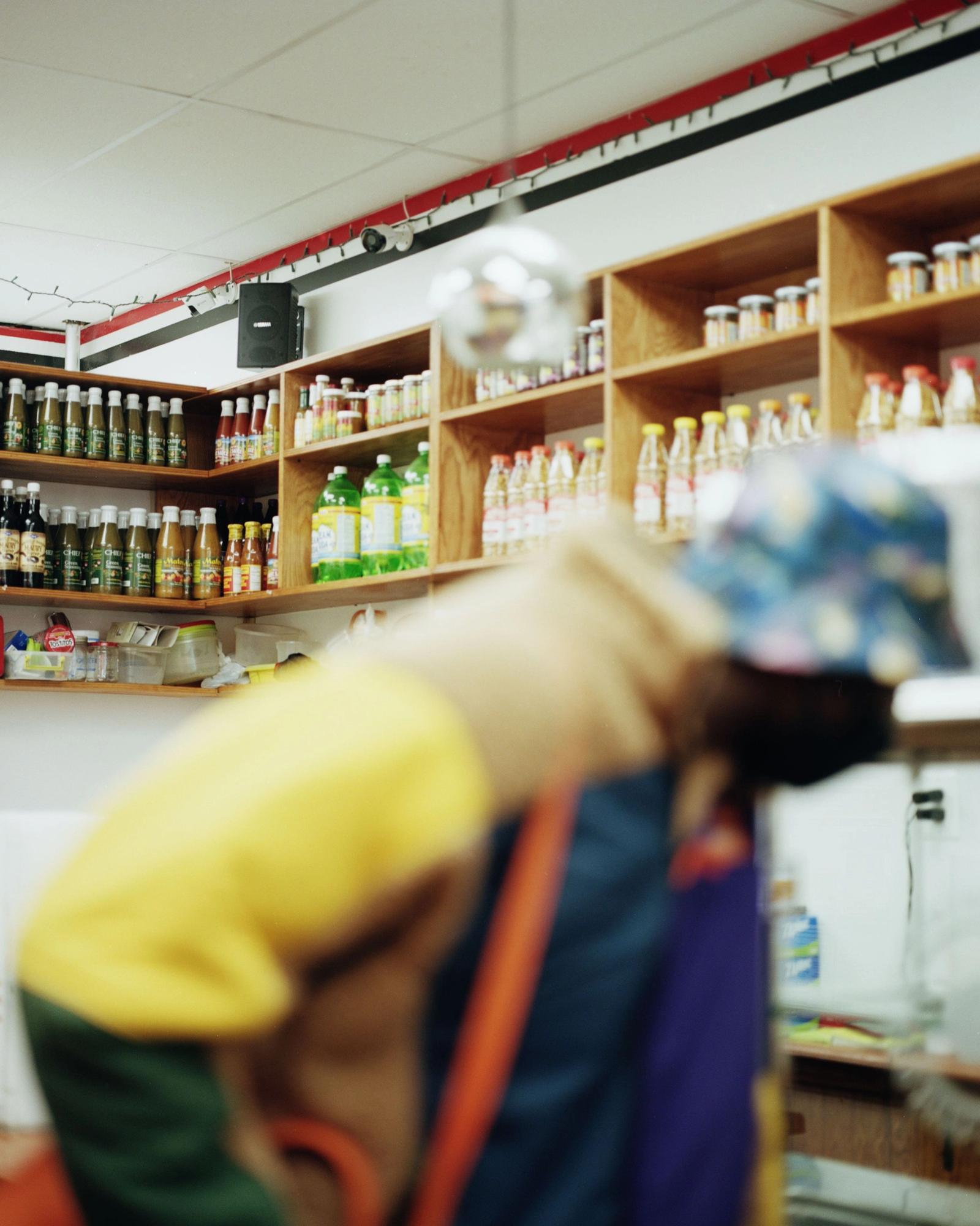 Shelves of beverage.