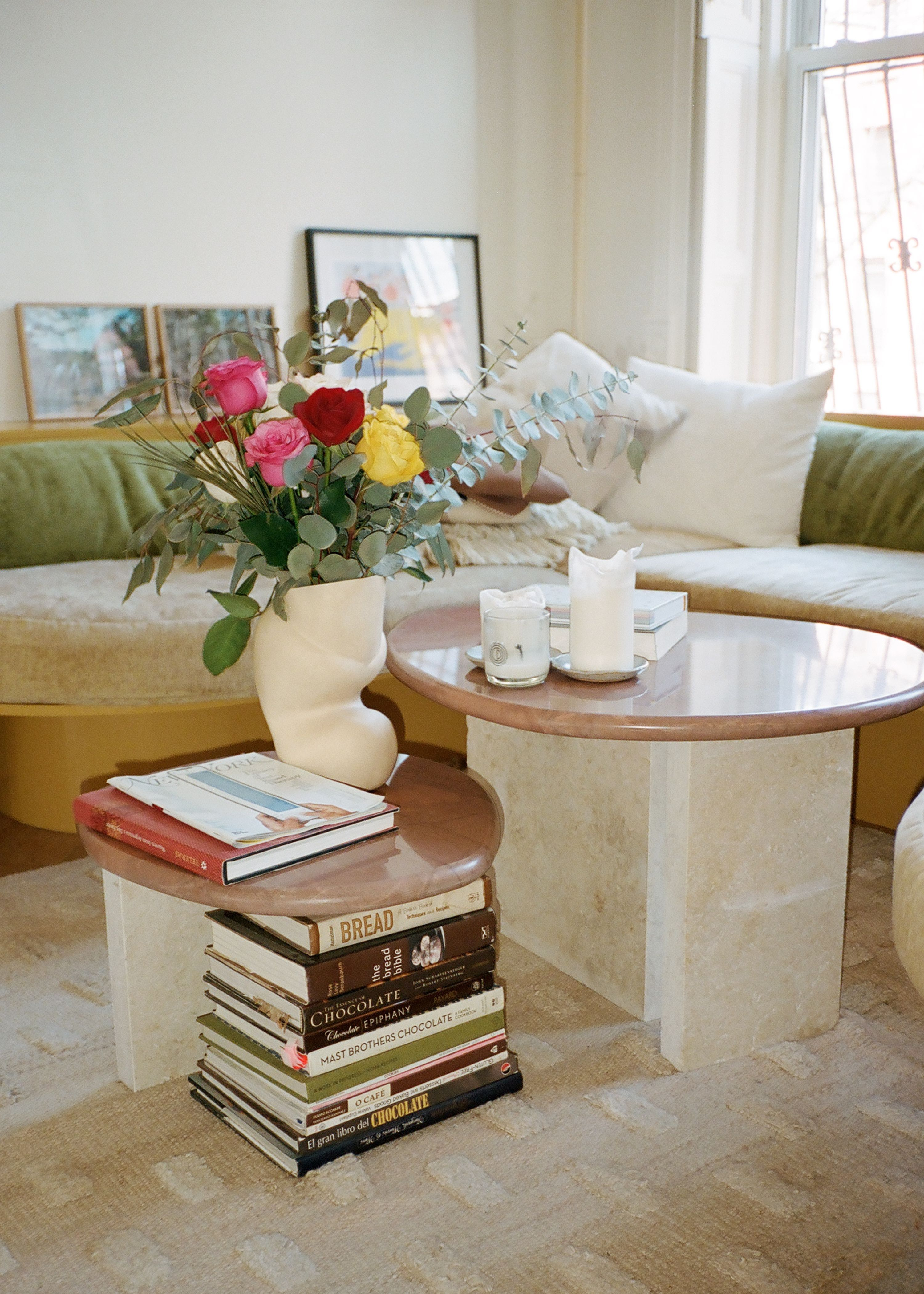 marble and wood coffee table. colorful flowers in an abstract vase