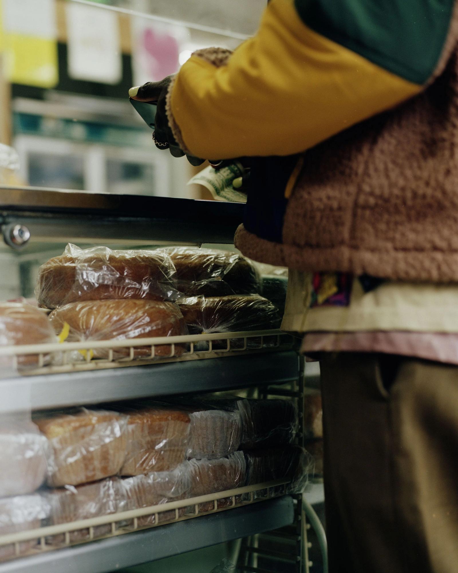 Devonne Francis purchasing bread.