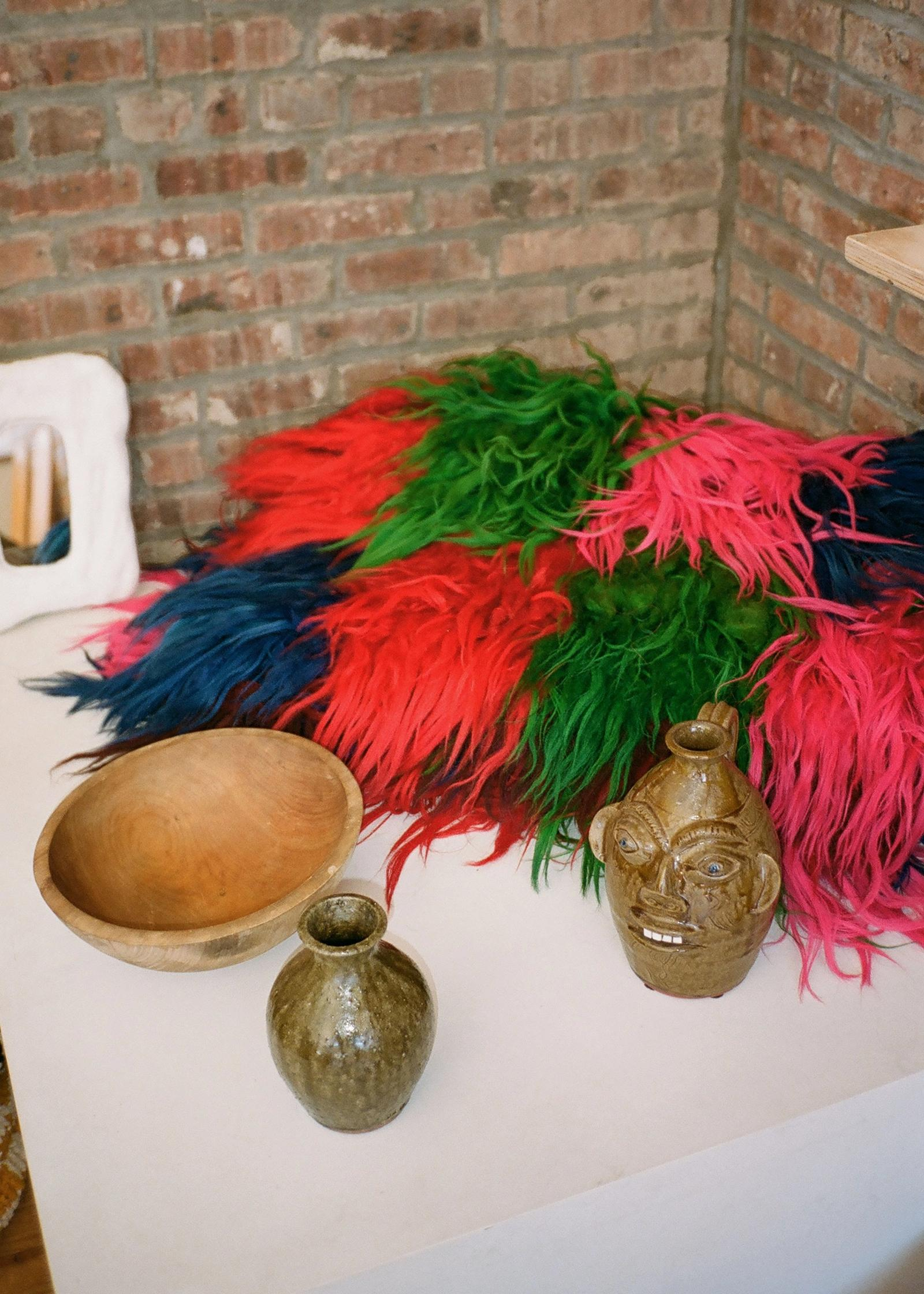feathers and vases on a table at raini home