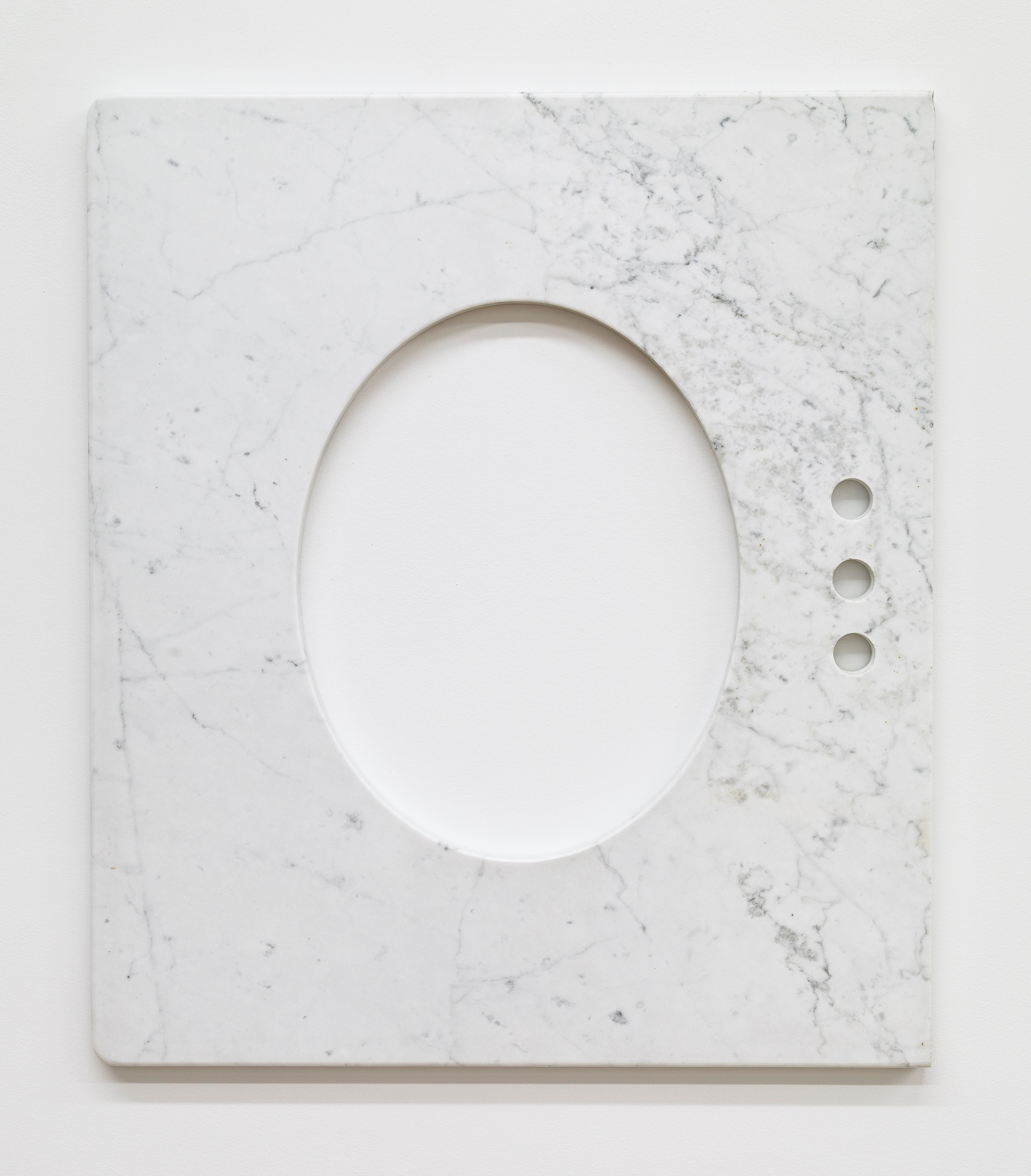 Marble panel with a large oval cut into it.