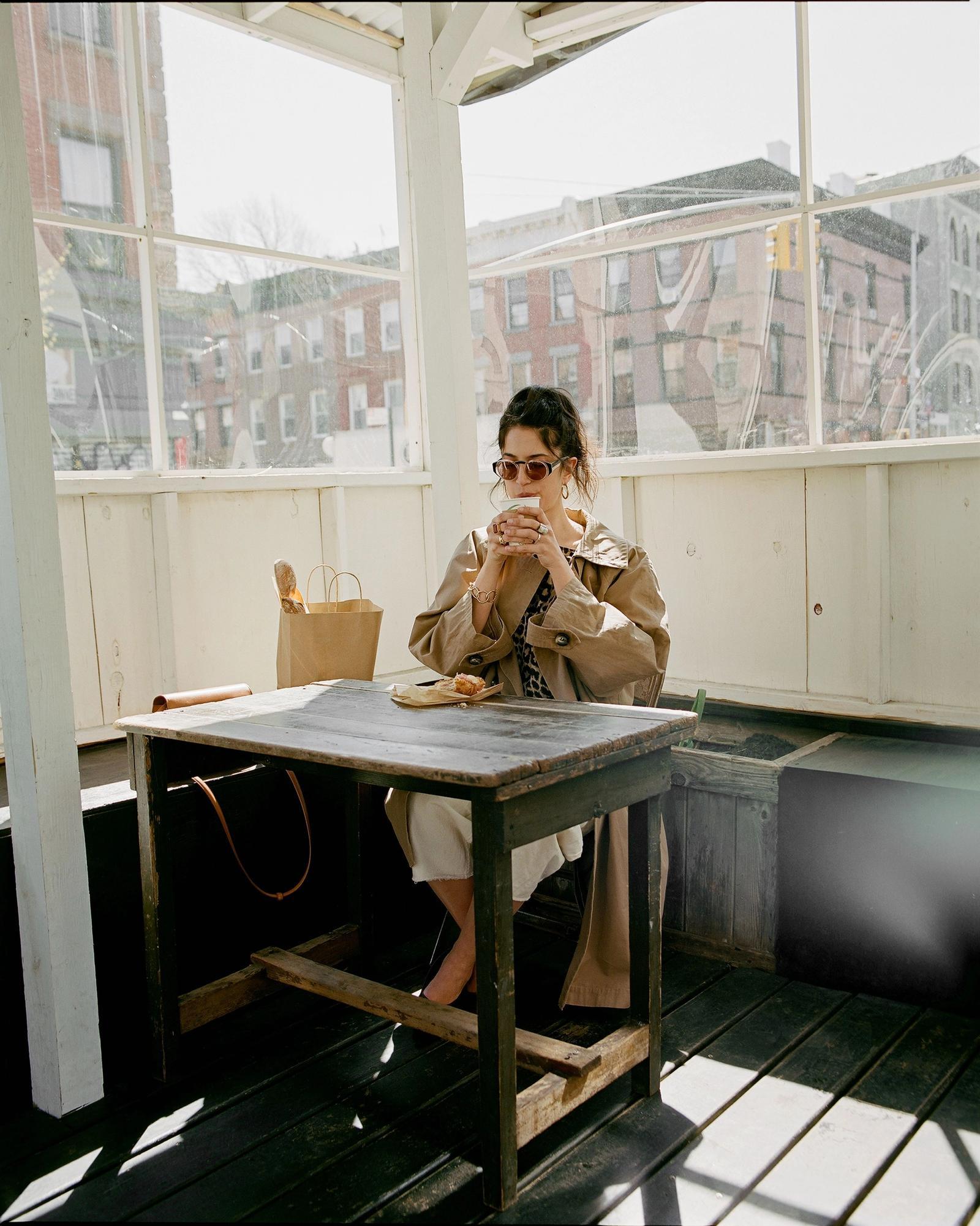 anna polonsky drinking coffee at SARAGHINA BAKERY