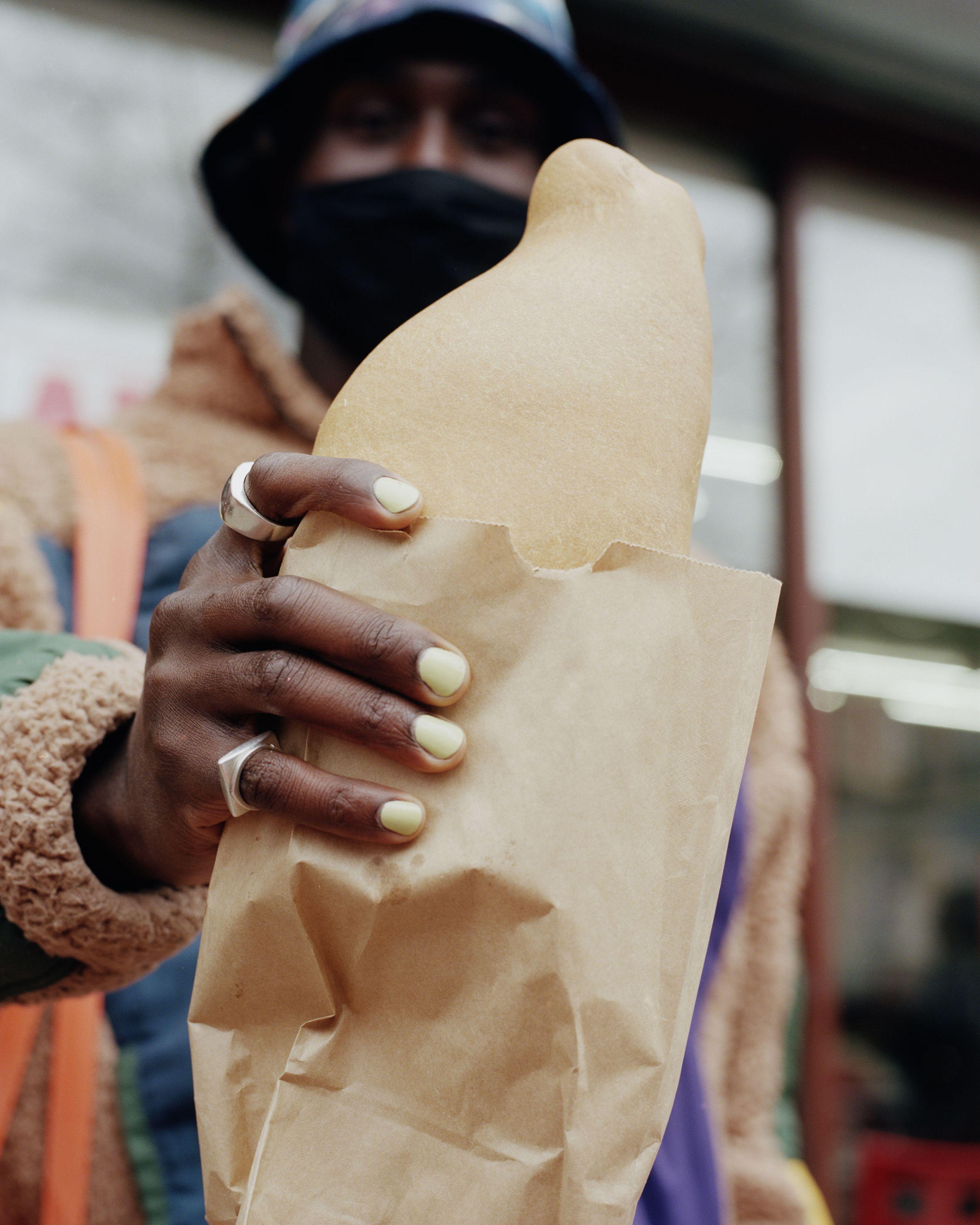 Devonn Francis holding an empanada.