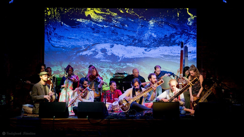 Brooklyn Raga Massive: In D, a group shot of the thirty-member Raga group