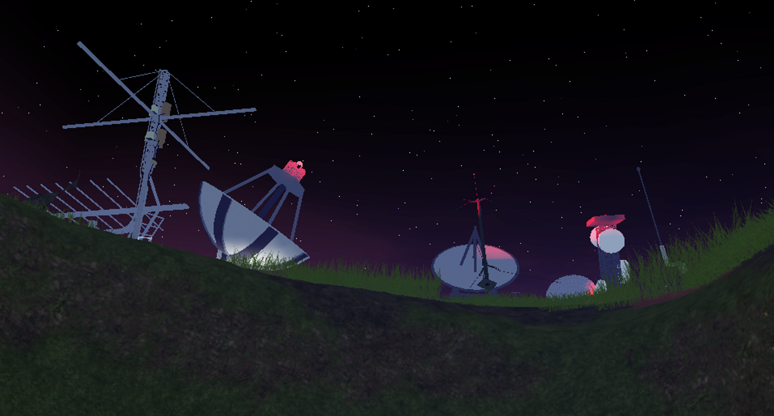 Satellite dishes up on a hill at night