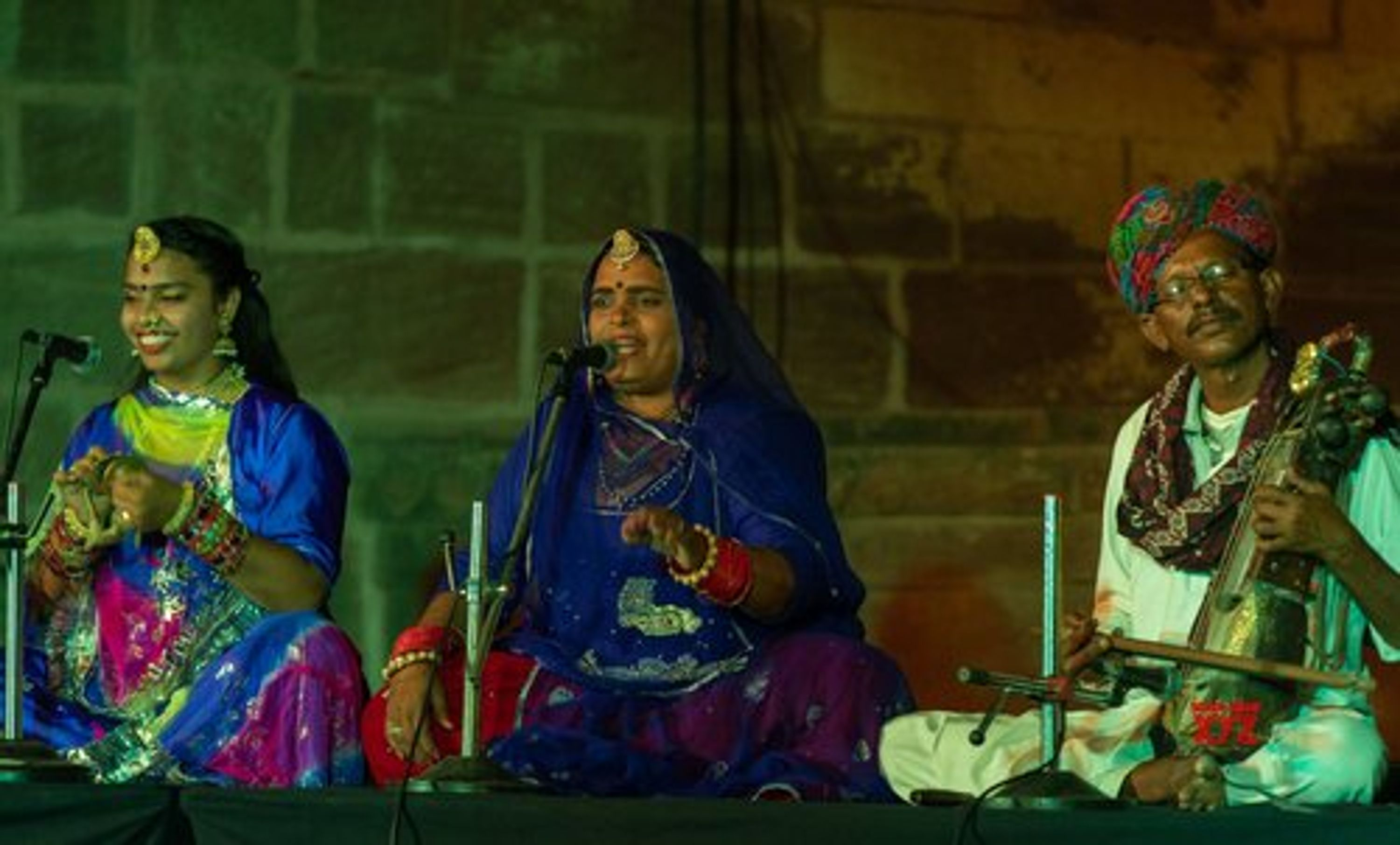 Womanly Voices (of Jodhpur Riff), three musicians sitting and playing