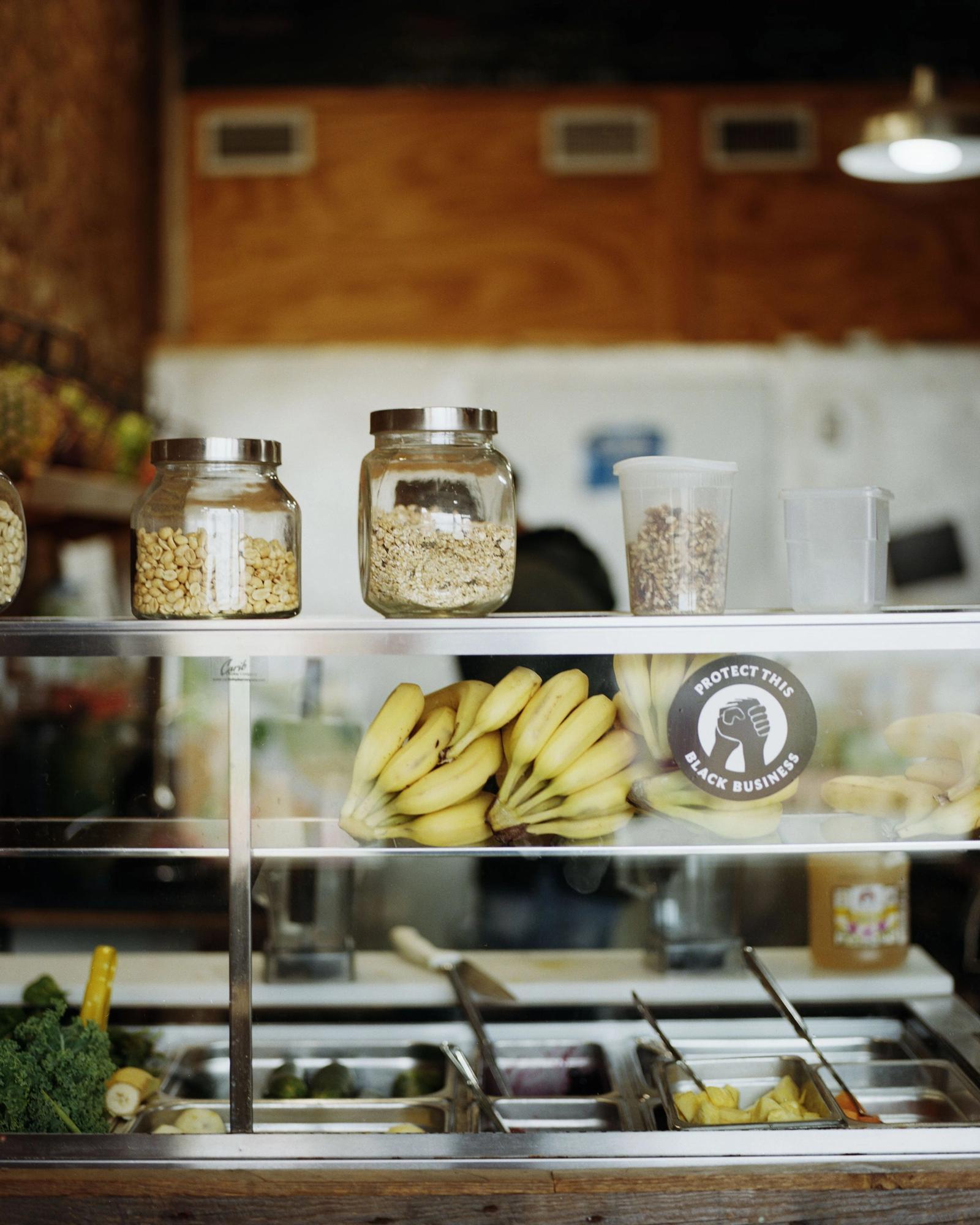 Grains and bananas artfully arranged on shelves.