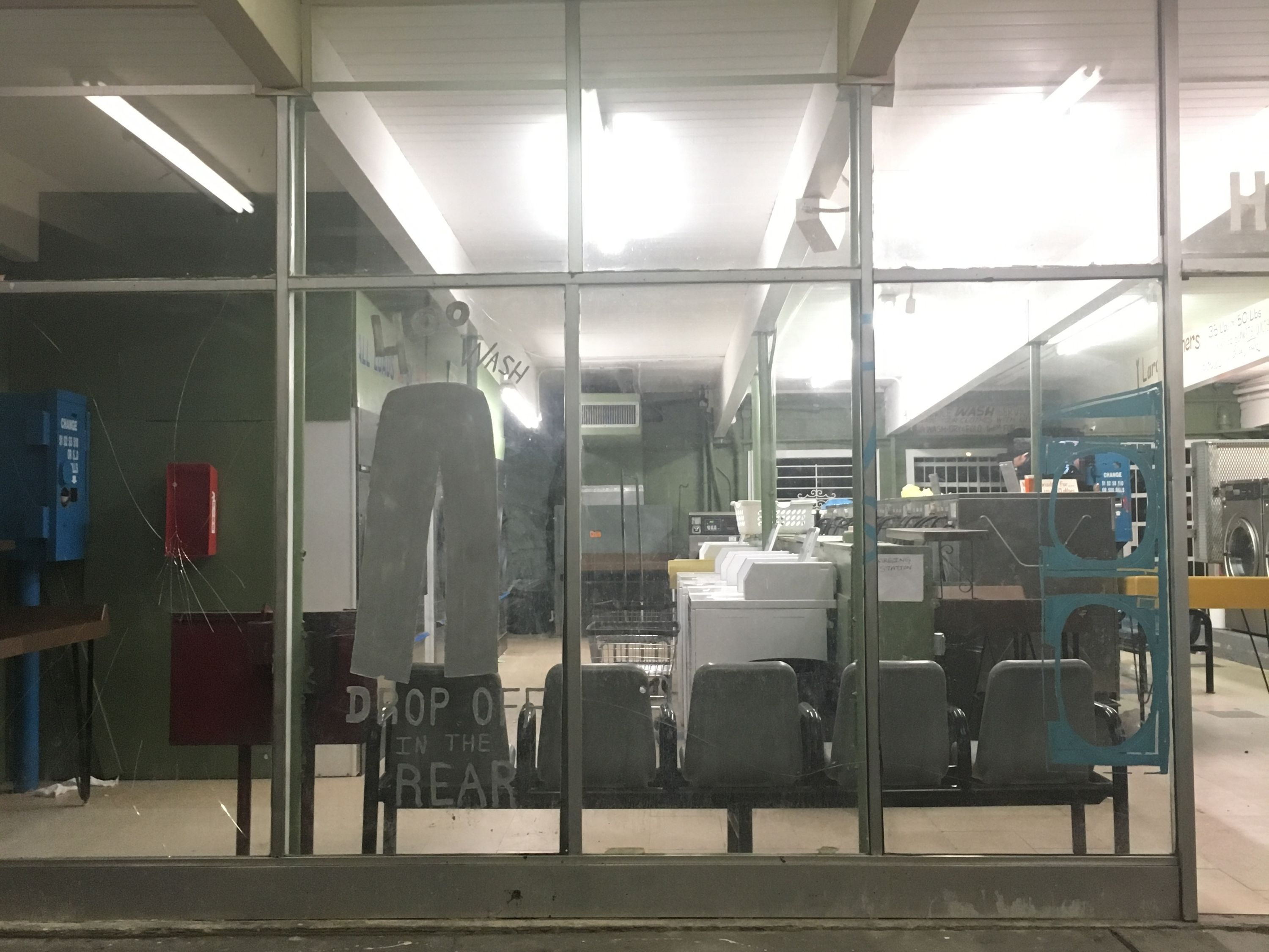 Photo of a laundromat taken from the street.