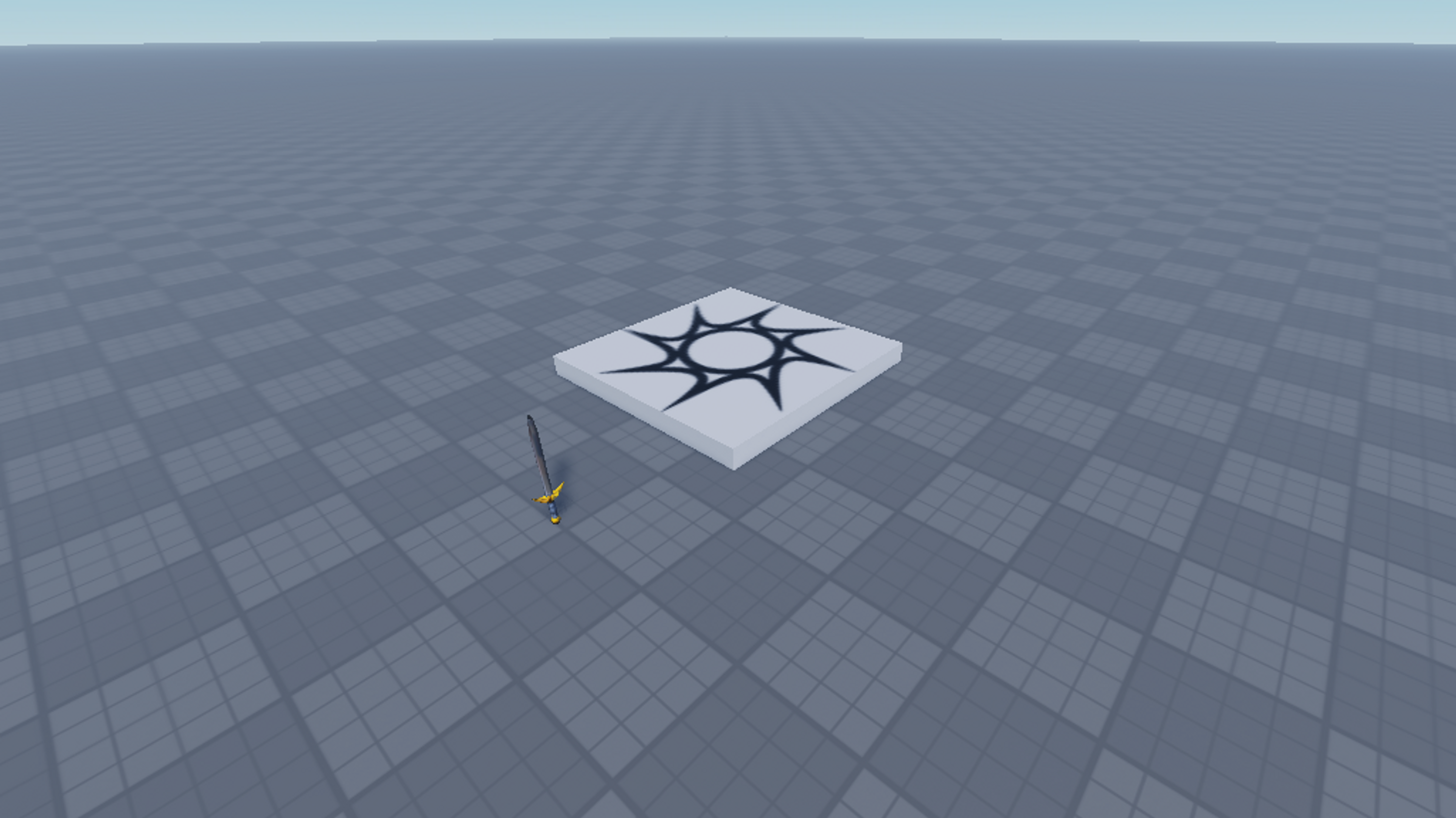 My test world, which includes a grey tiled baseplate stretching to the horizon and a sword.