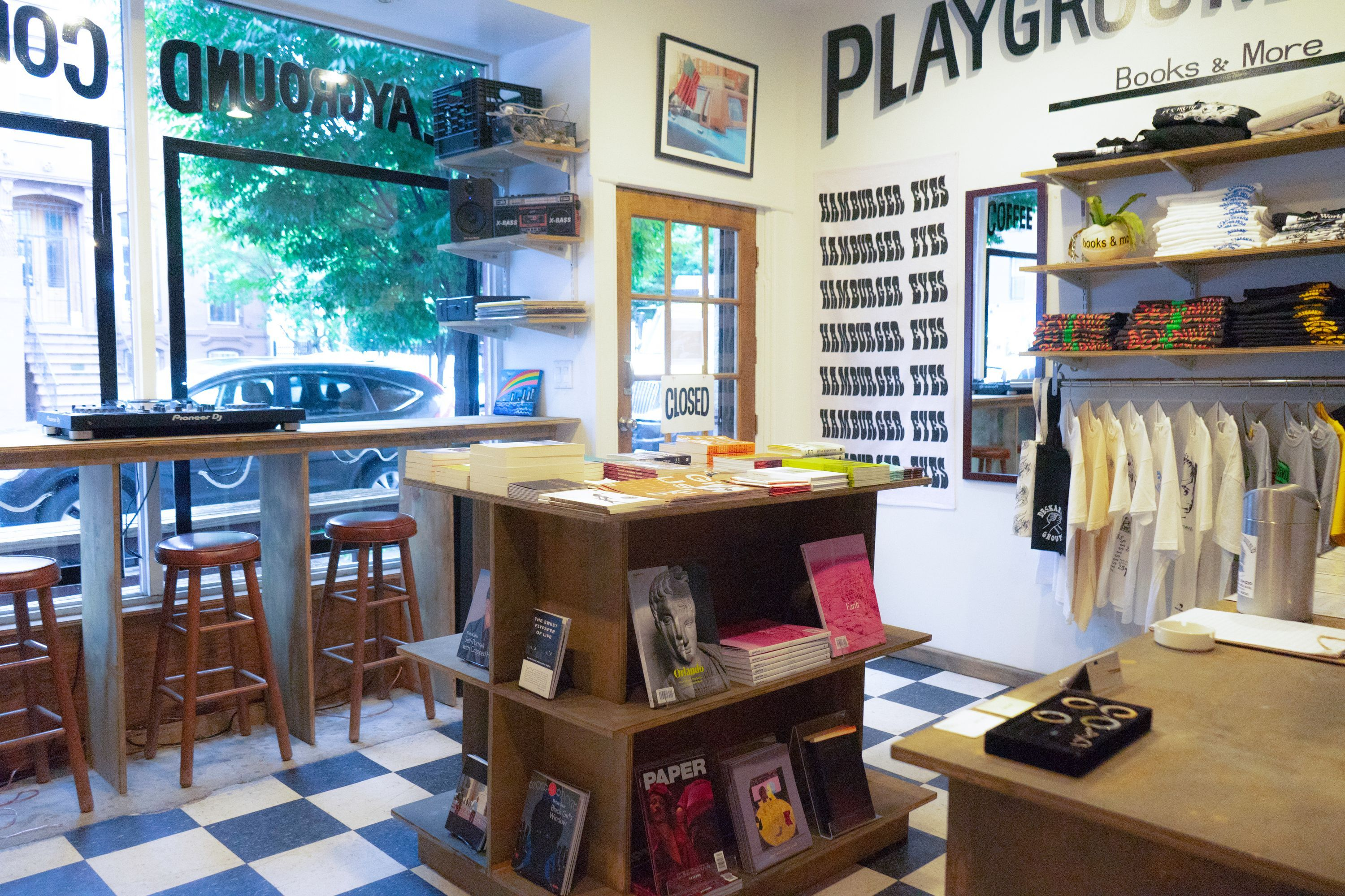 Interior of Playground annex with books and T-shirt displays.