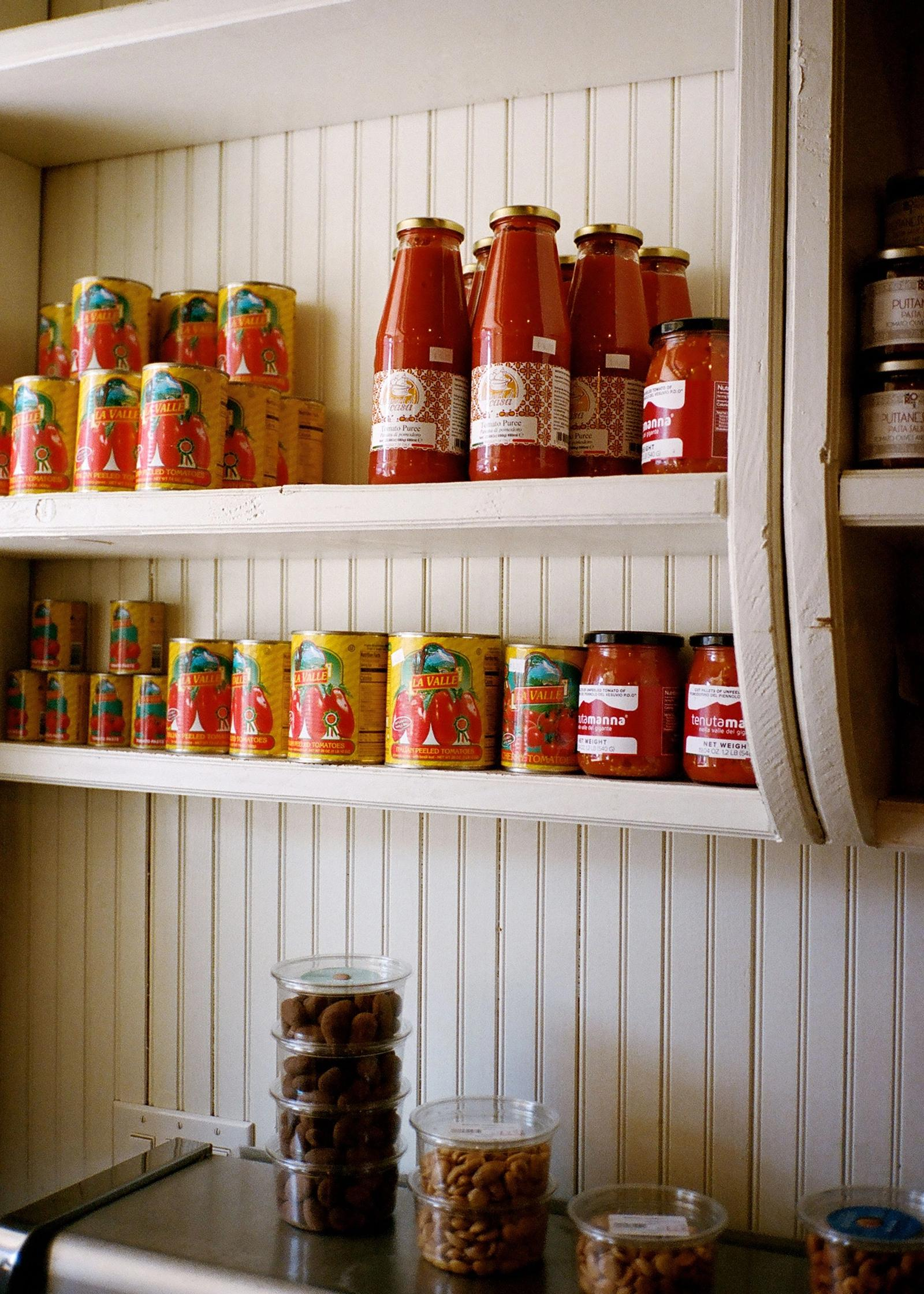 tomato sauce for sale on shelves at SARAGHINA BAKERY
