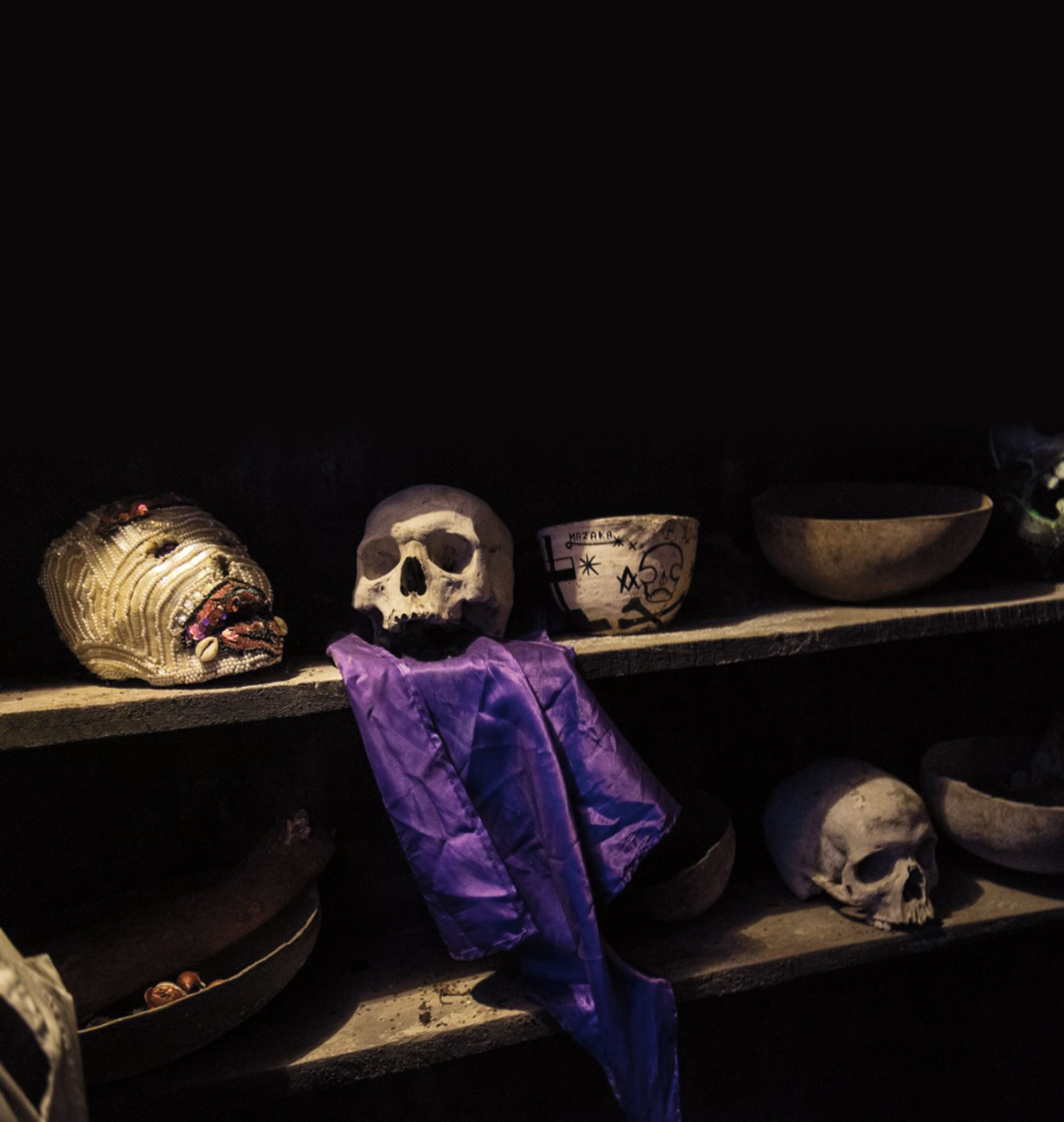 This altar for the Lwa Baron and the spirits of Gede is in a sacred chamber and healing sanctuary of Temple Na-Ri-VéH. The skulls symbolize life and death, the duality in mankind and purple is the favourite colour of the Gede spirits.