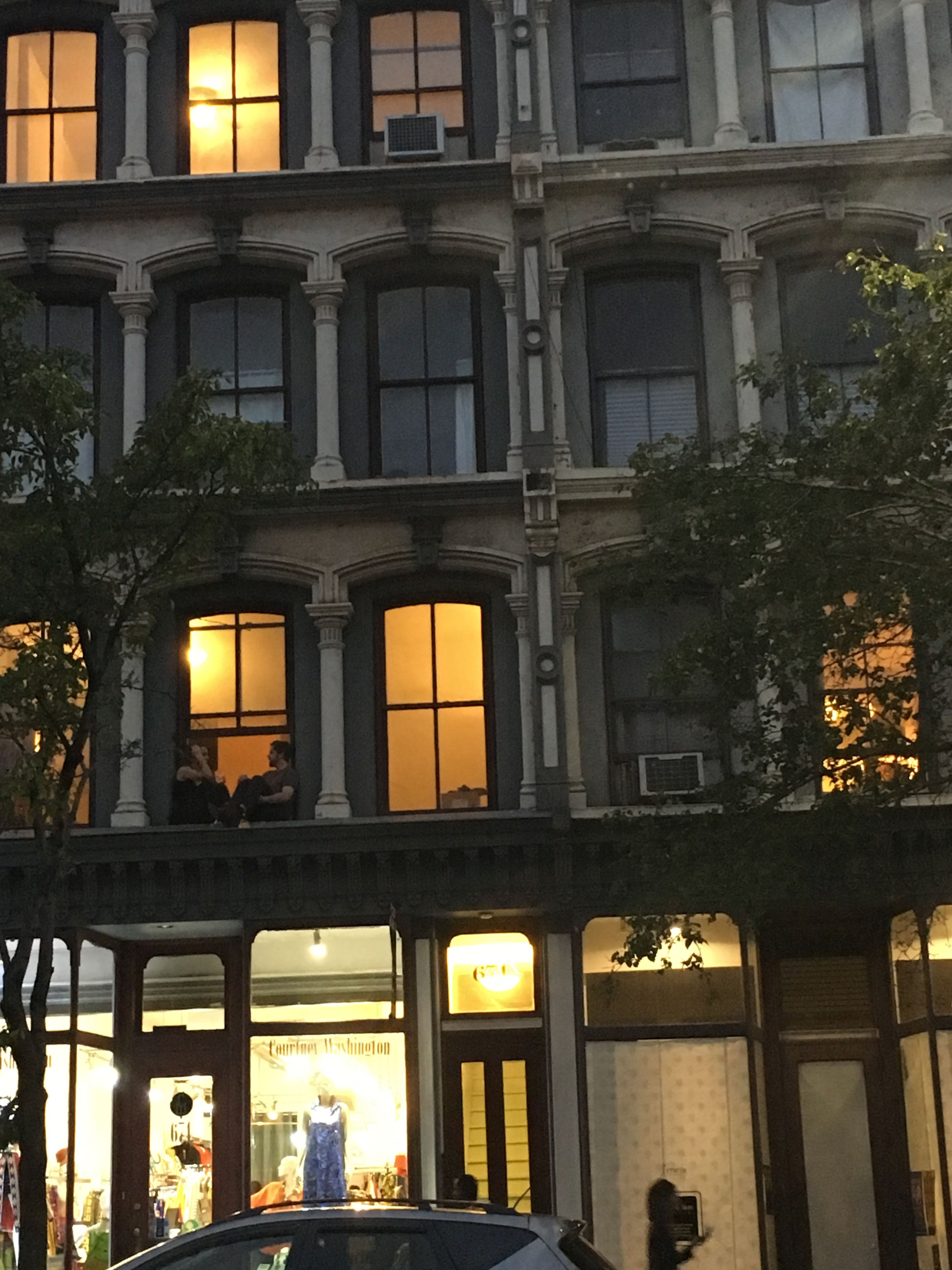 Photo of a New York City apartment's windows from the outside.